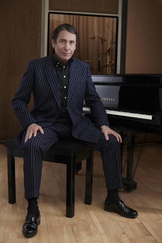 Jools Holland sitting in front of piano