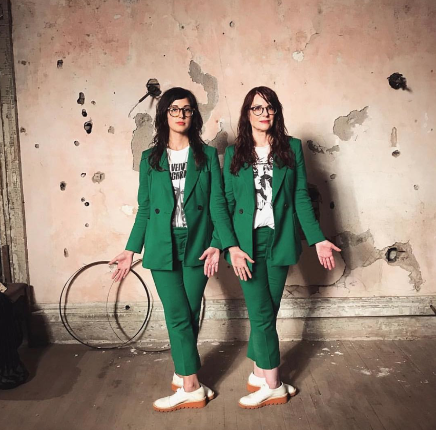 Nancy and Beth in green suits