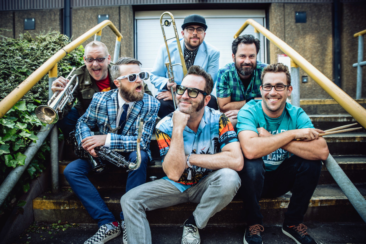 Reel Big Fish sitting outside on stairs