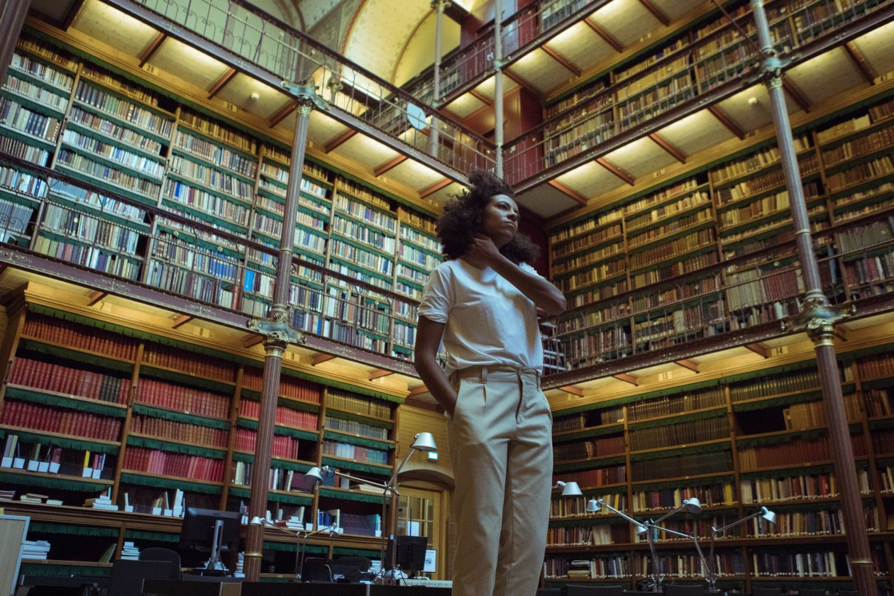 Nana Adjoa standing in library