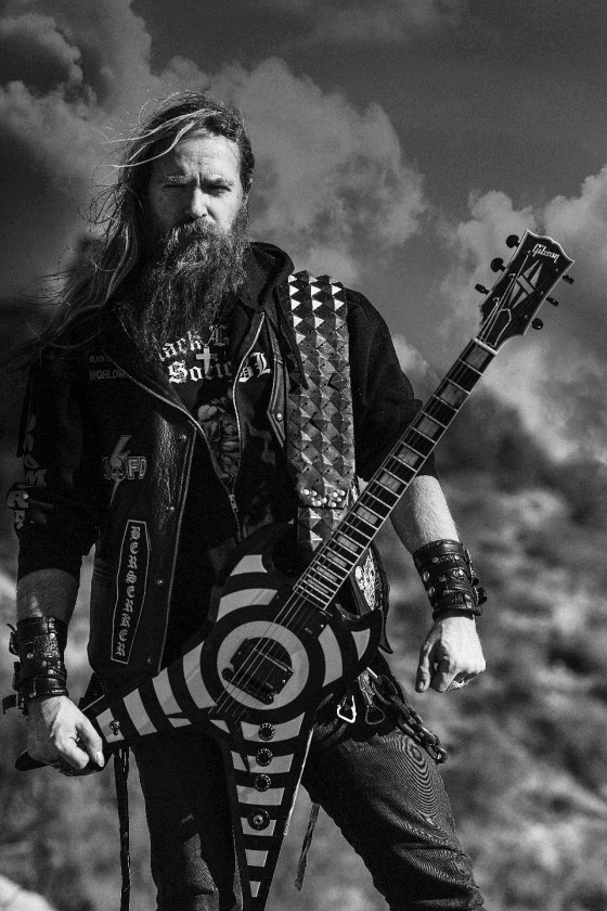 Black Label Society black and white photo outside with guitar
