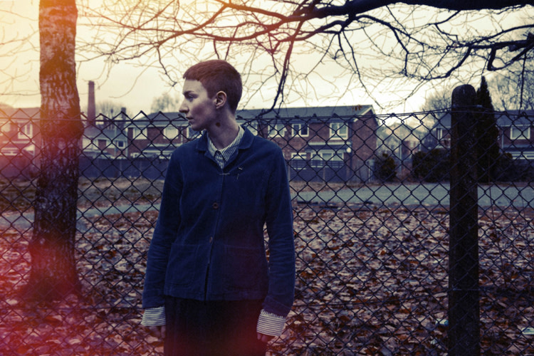 LoneLady photo standing outside in front of fence