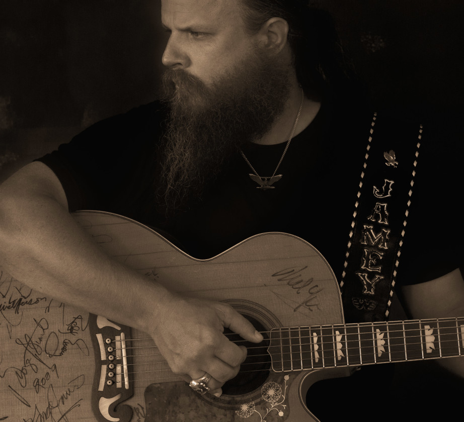 Jamey Johnson holding guitar