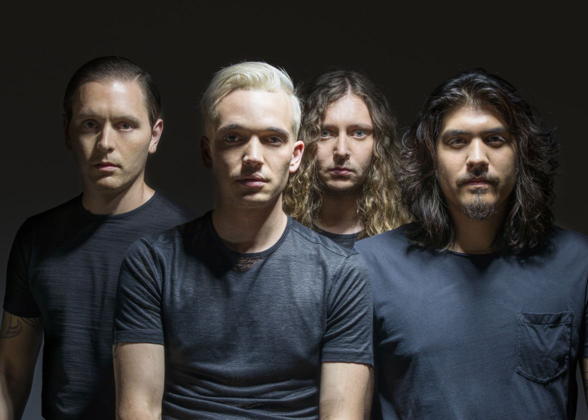 Badflower in front of dark background