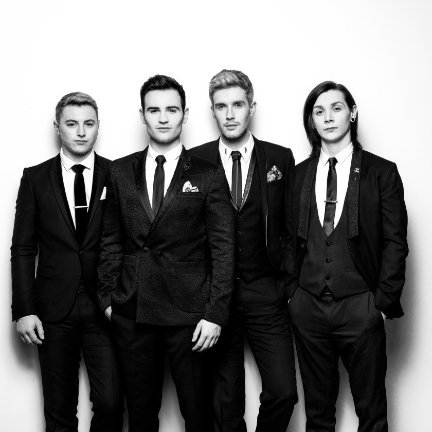 Collabro black and white portrait wearing suits