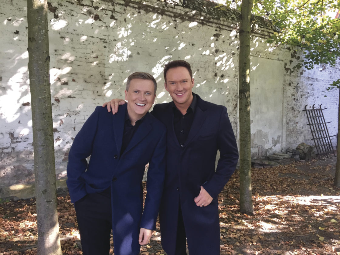 Aled Jones and Russell Watson standing outside together