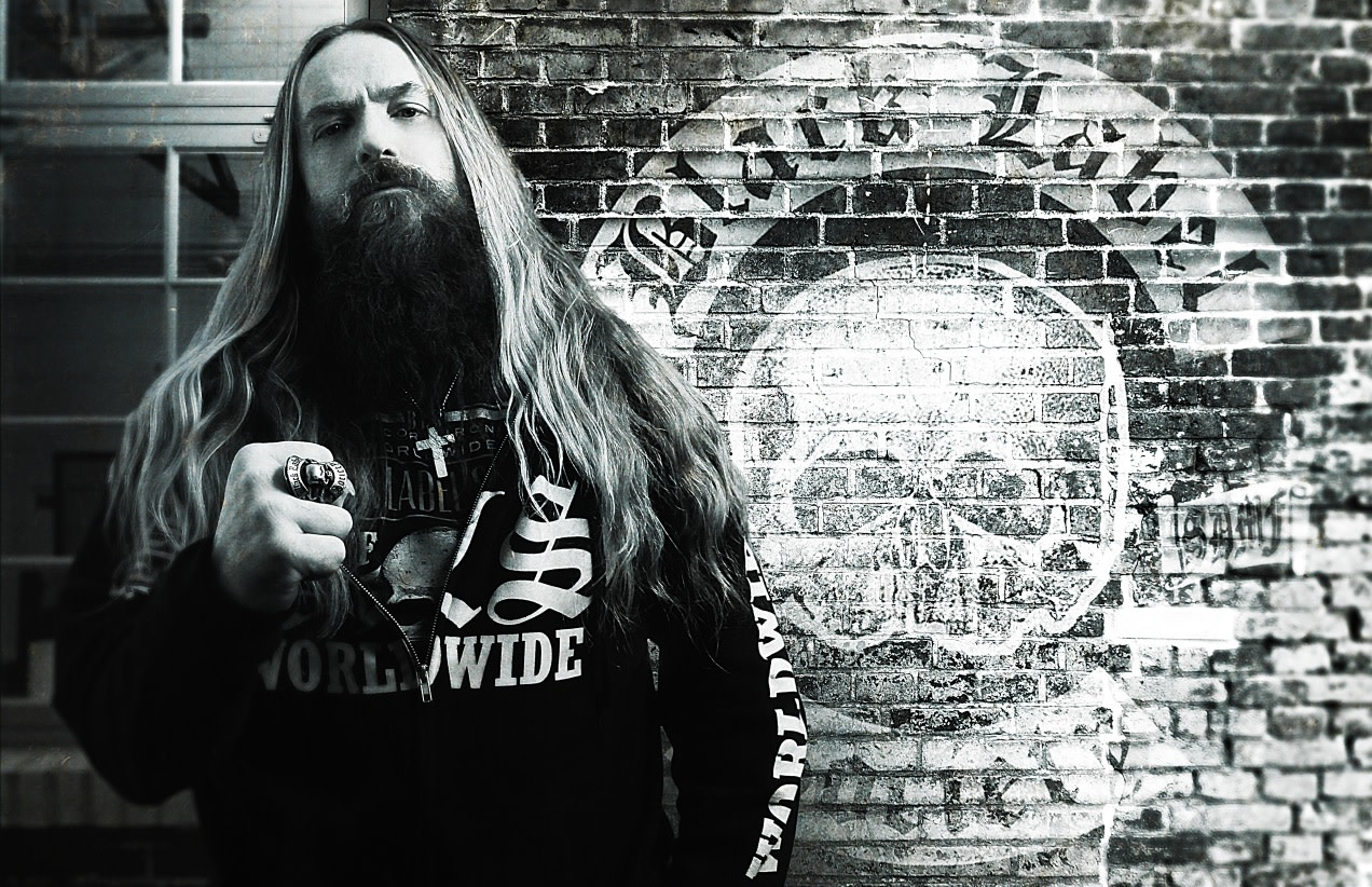 Zakk Wylde black and white photo in front of painted wall