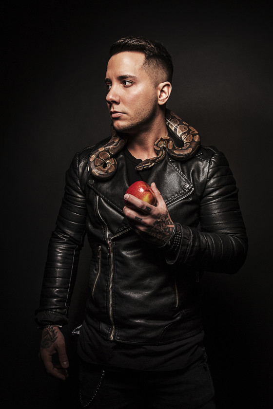 Carter Winter wearing leather jacket with snake holding apple