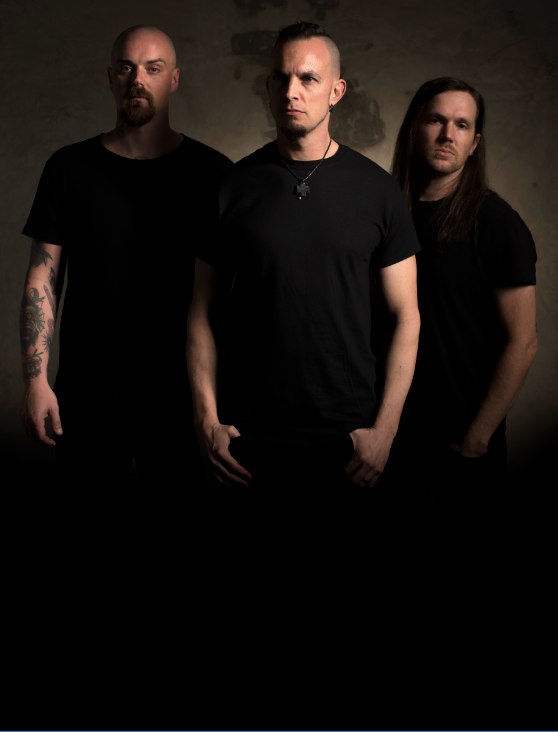 Tremonti group in front of dark background