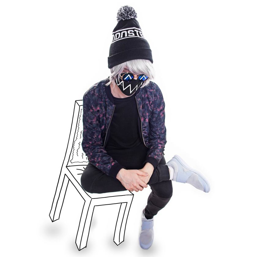 Tokyo Machine sitting on illustrated chair wearing mask and ski hat