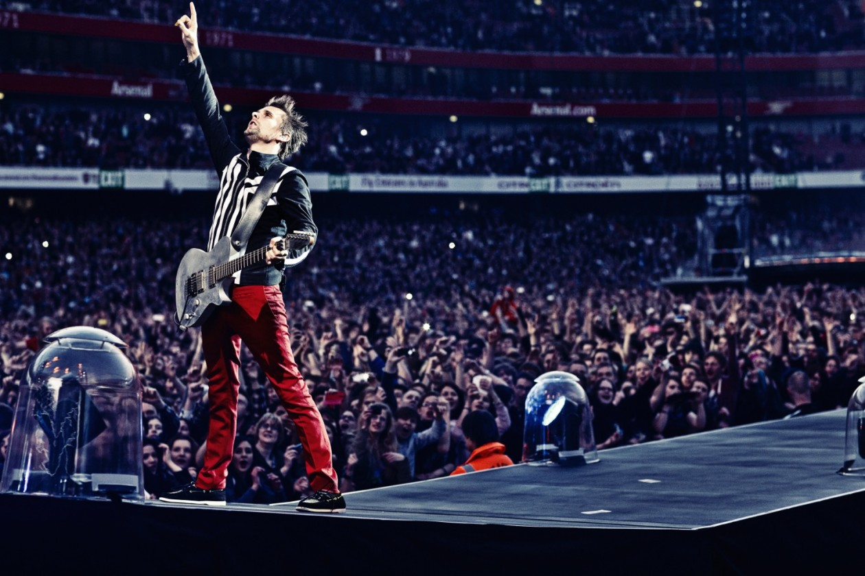 Muse on stage in front of crowd
