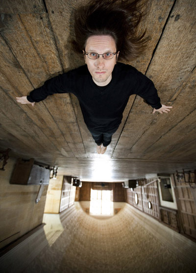 Steven Wilson portrait upside down on wood floor
