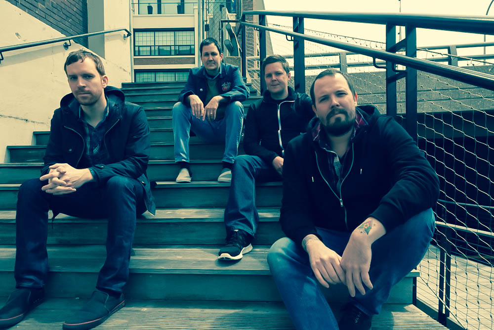 Braid band photo sitting on stairs outside