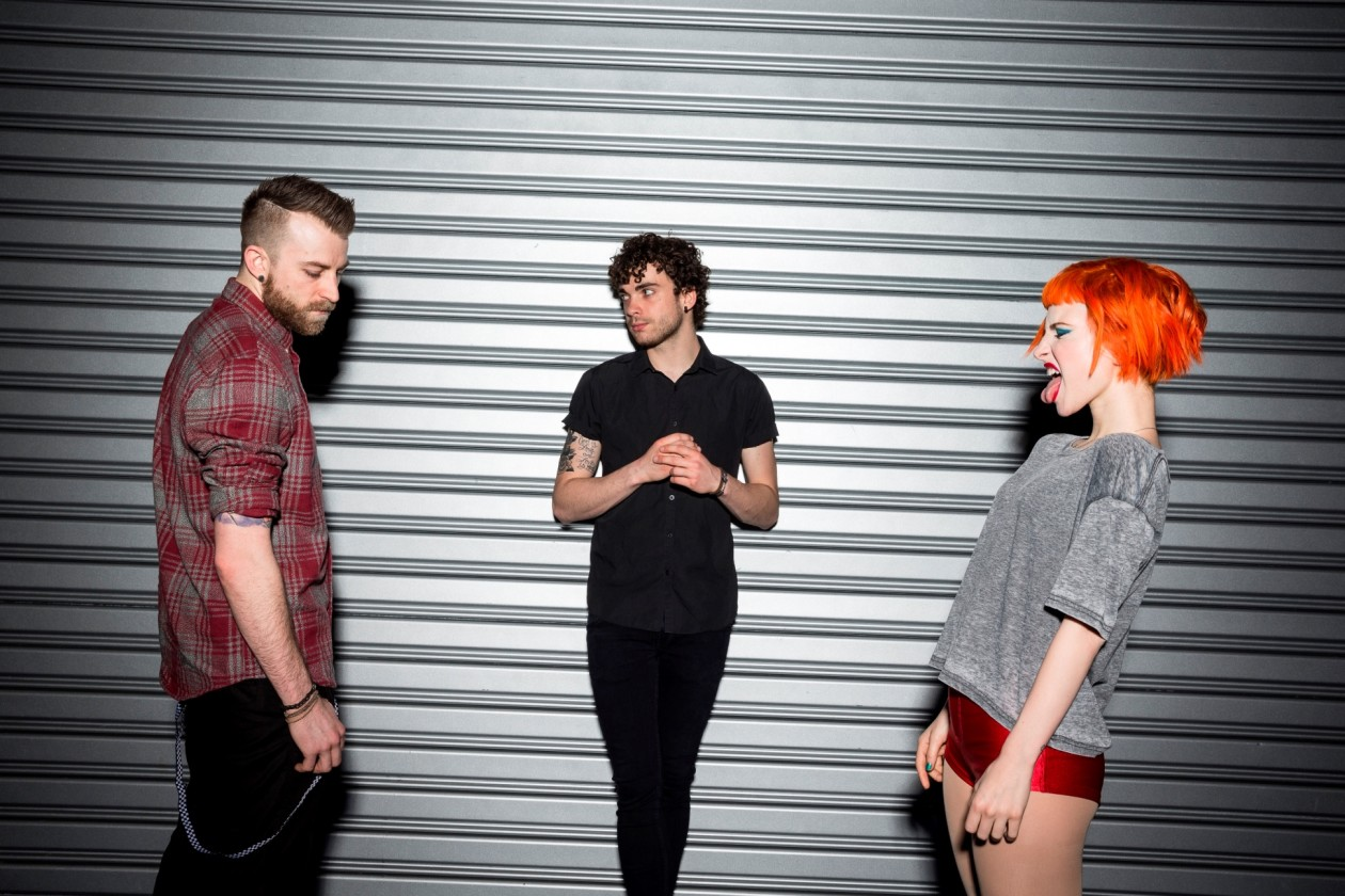 Paramore photo in front of metal wall