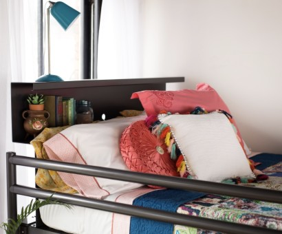 Close up on a top bunk bookshelf on a charcoal Queen Over Queen Adult Bunk Bed