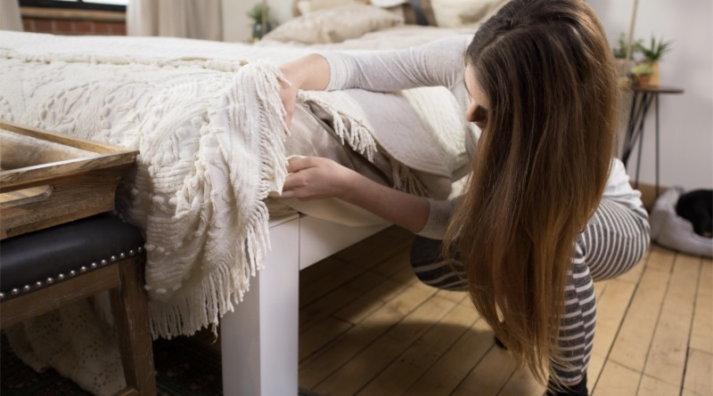 Woman Looking Under Standard Bed 800x445%