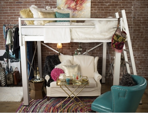 A high angle shot of a full size Adult Loft Bed with a cream colored love seat under it.