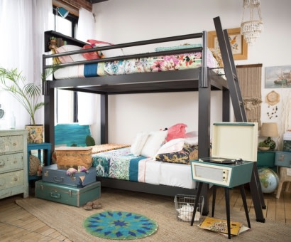 A charcoal Queen Over Queen Adult Bunk Bed in an apartment bedroom shared by two young adult roommates.