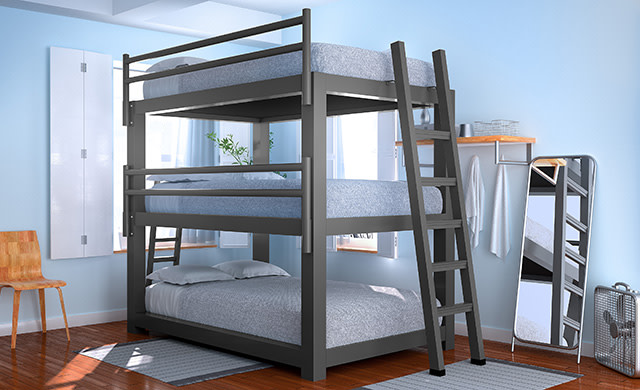 A charcoal Full XL Triple Bunk Bed in a hostel