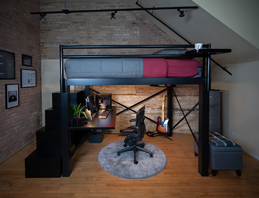 A black Queen Loft Bed in a young adult gamer's bedroom
