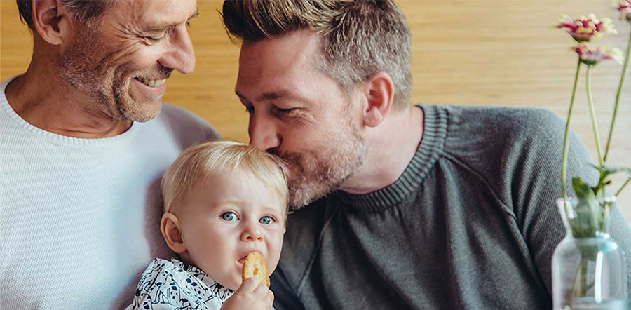 vertical-card-baby-being-kissed-by-dad-at-breakfast-table-626415.png