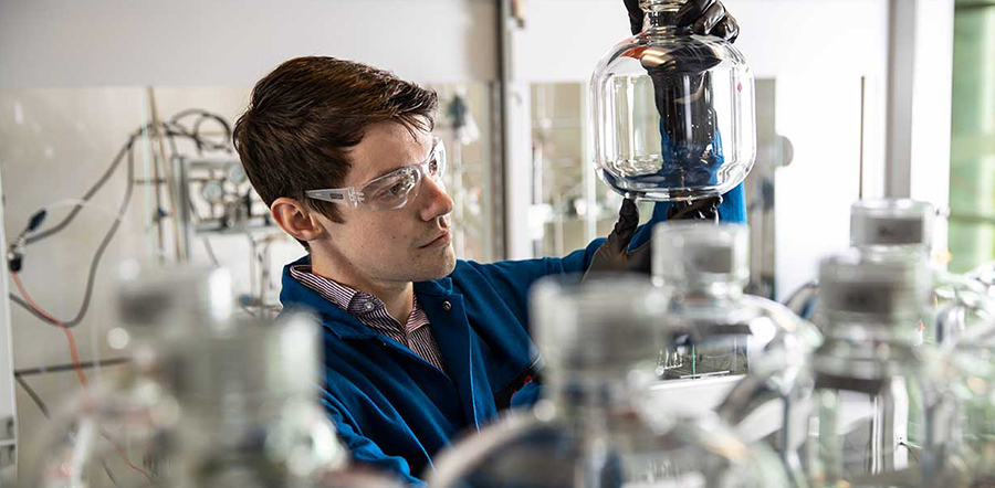 Scientist looking at empty glass jar