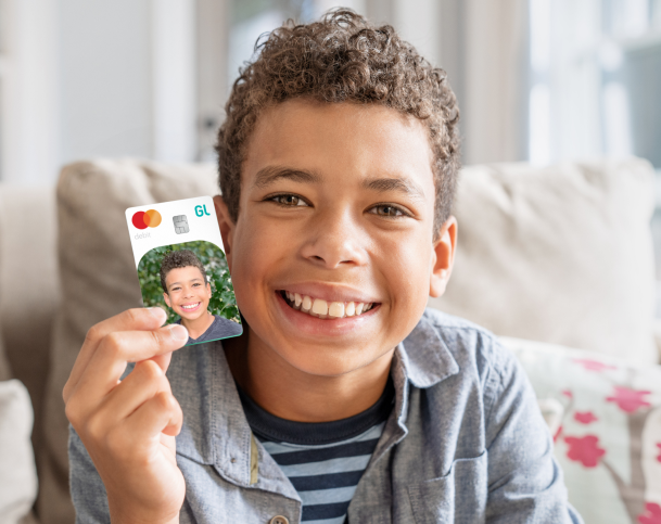 Child holding a Greenlight card