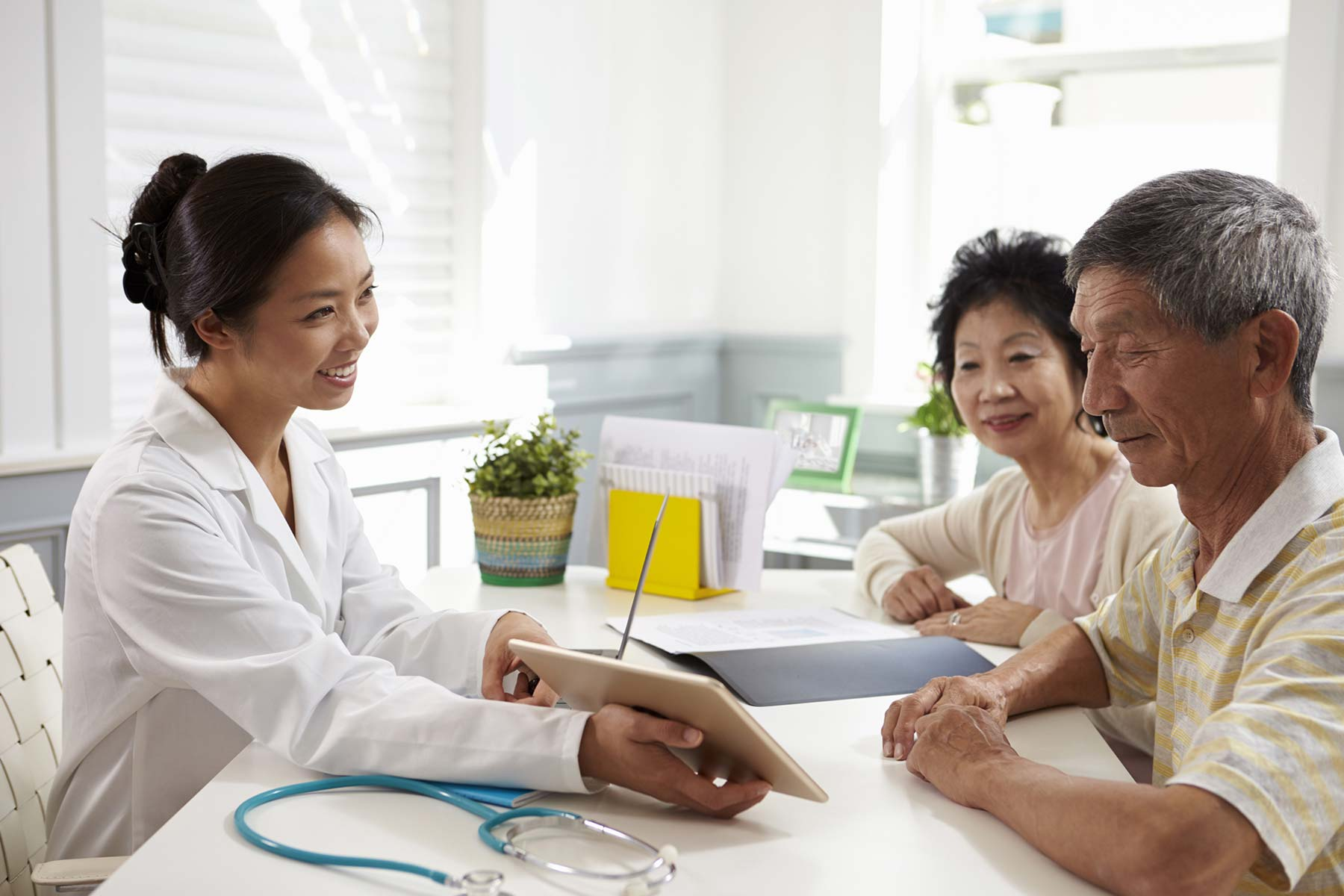 doctor talking to patient family 1800 x 1200