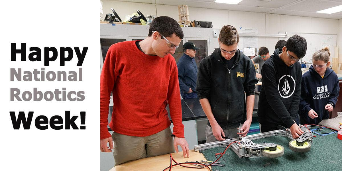 Young adults building robotic components together