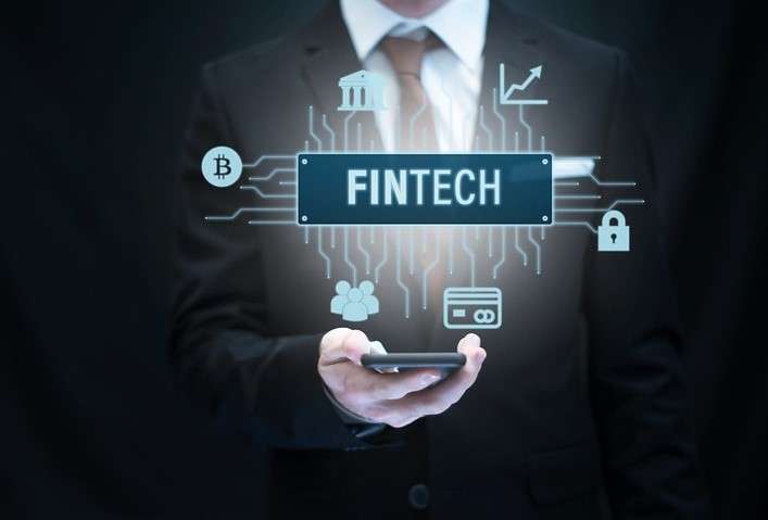 Business Person Holding Smartphone with Fintech Icon