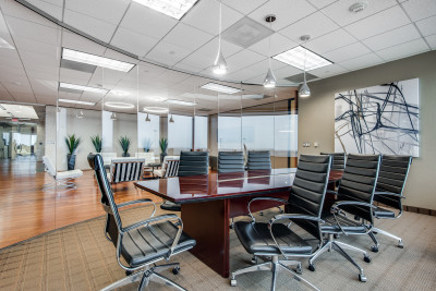 Eight person conference room available to rent for corporate meetings