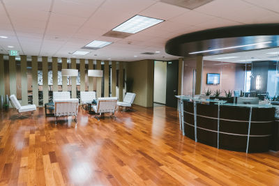Reception area in executive suite rental space with private offices