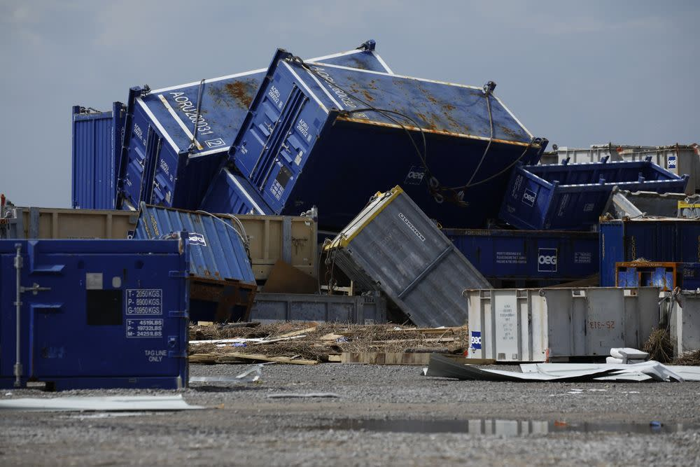 Offshore oil supply containers are strewn about after Hurricane Ida's storm surge swept through Port Fourchon, Louisiana. Photographer: Luke Sharrett/Bloomberg