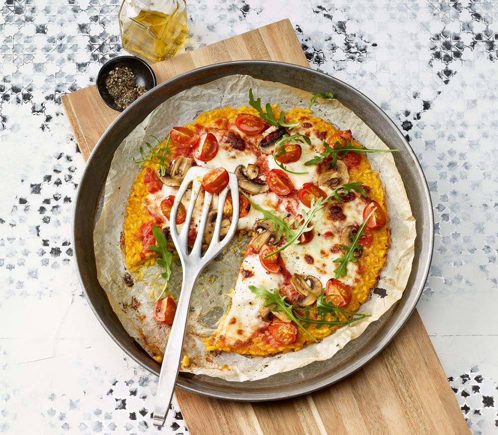 "<a href=""https://www.wildeisen.ch/rezepte/risotto-pizza"" target=""_blank"">Risotto-Pizza</a>"