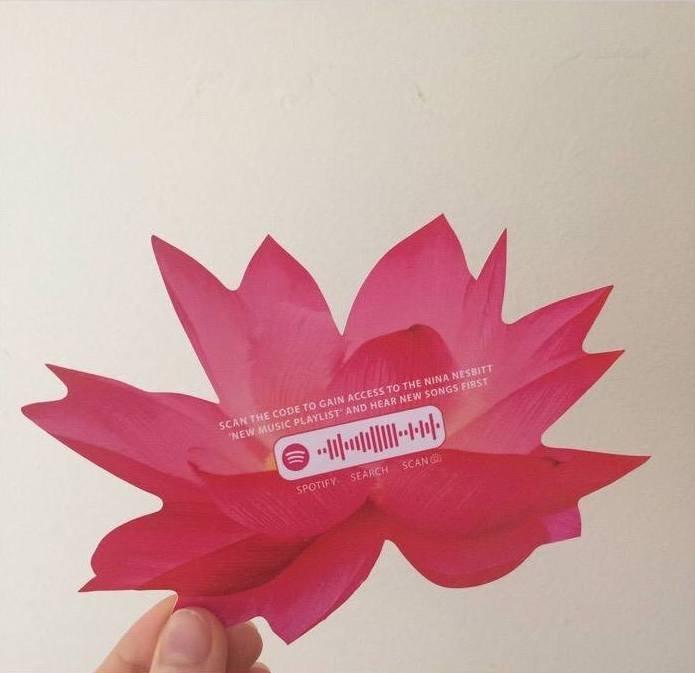 "Nina Nesbitt's ""Lotus Flower"" sticker, featuring a Spotify Code. ""I've seen a rise in Followers since the stickers went out, and I also hand them out at all my shows for people to share."""