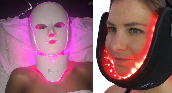 Two women with LED light machines attached to their faces as a skin care treatment