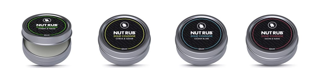 Four metal cans of Nut Rub lined up in a row
