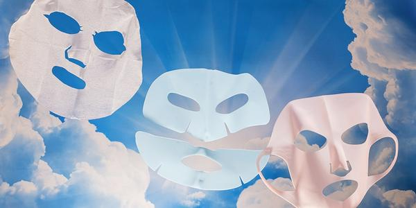 Three sheet masks with a blue sky background