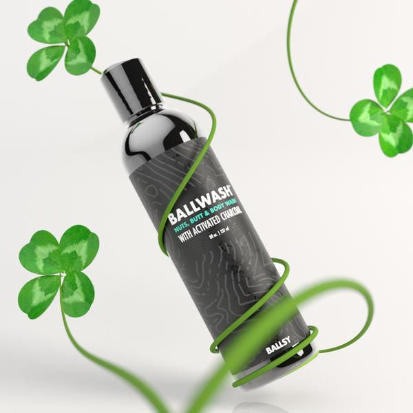 A bottle of Ballwash surrounded by four-leafed clovers