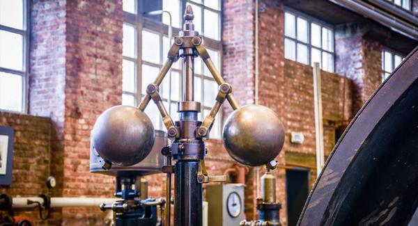 Metal governor balls on a steam engine