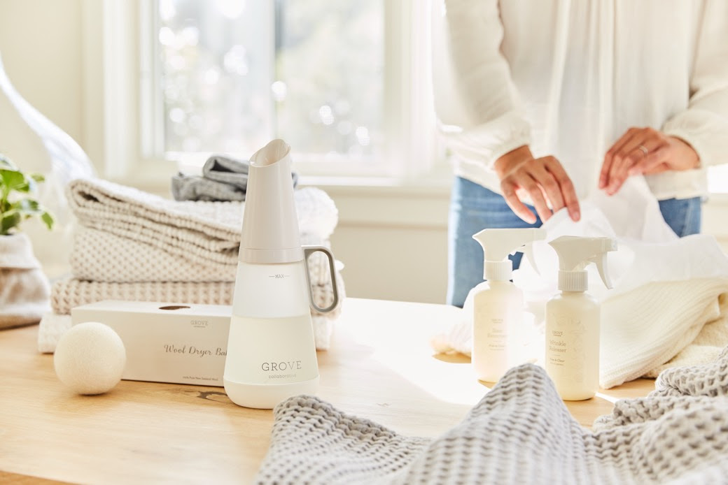 Natural laundry products on a table while an adult uses them to clean their comforter.