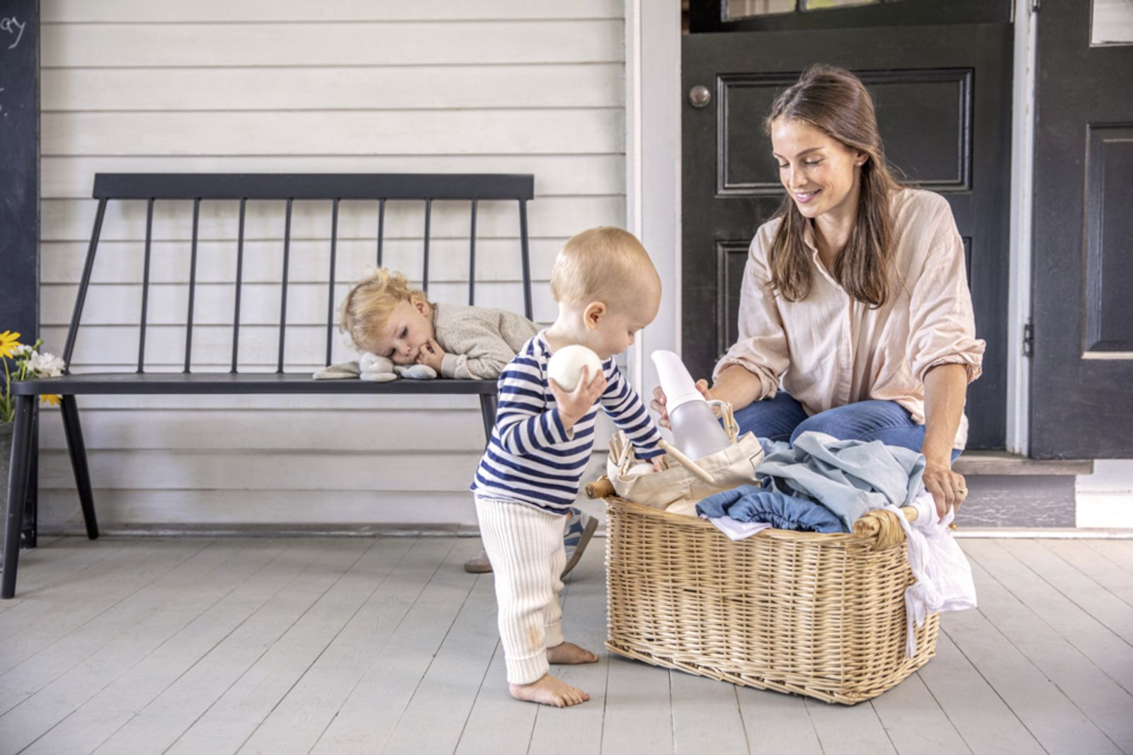Woman and children with laundry basket