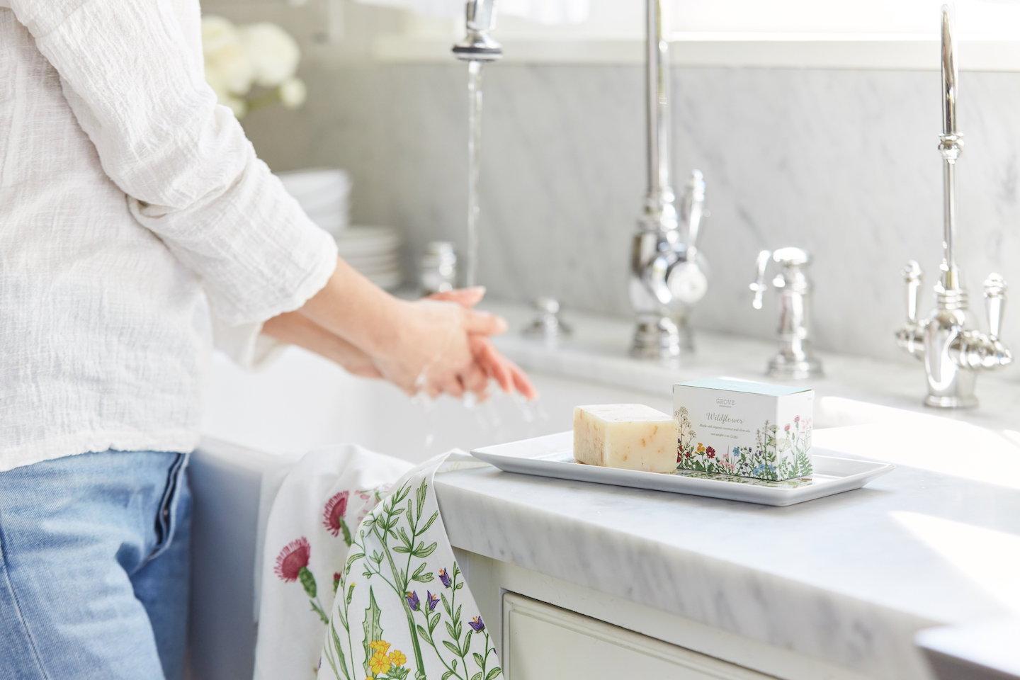 woman washing hands with grove bar soap