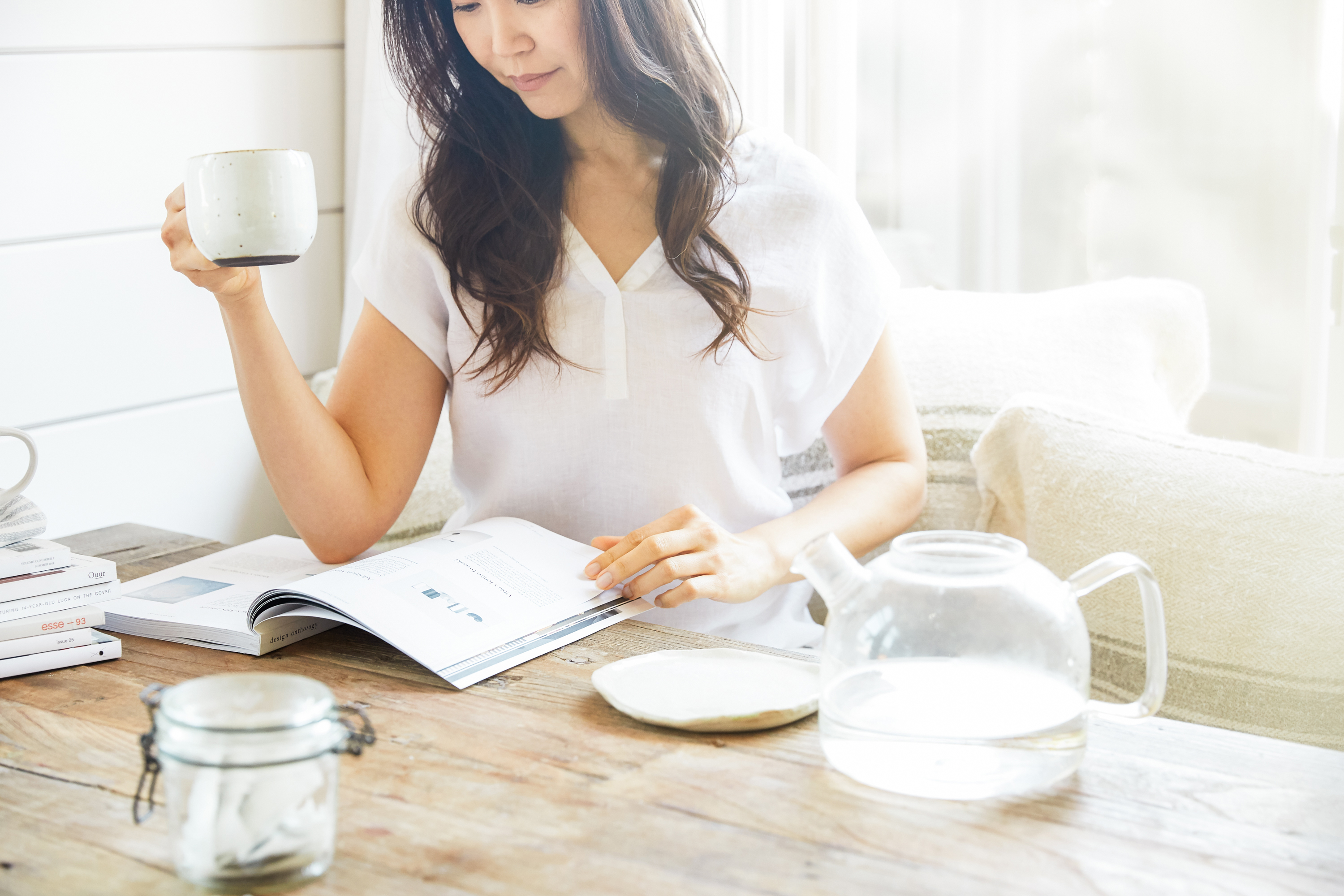 woman reading a book with a mug of coffee