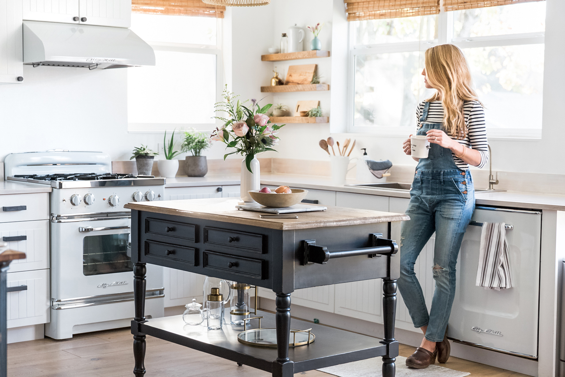 Photo of woman standing in kitchen