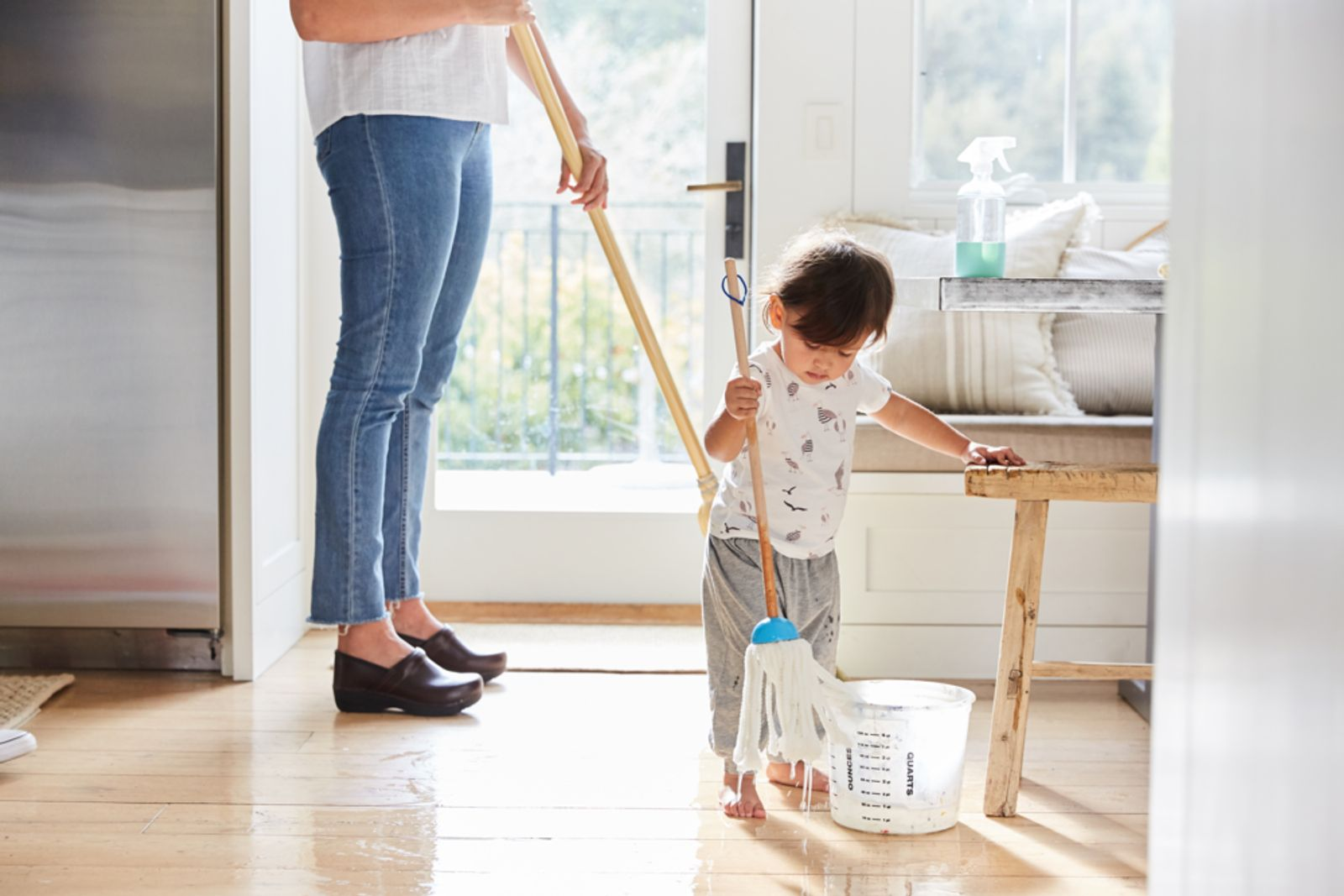 Woman and child mopping floor