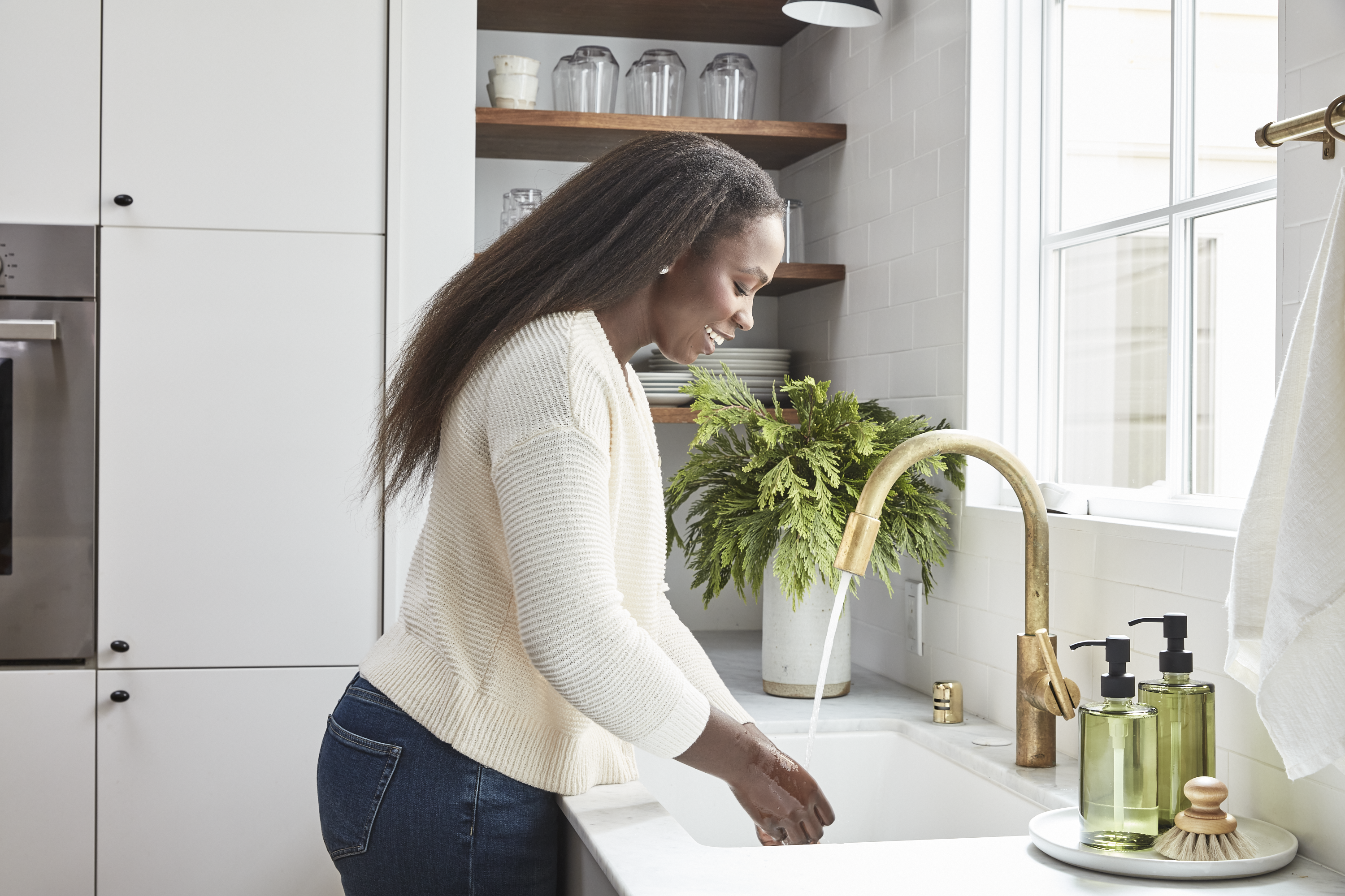 Woman washing hands at sink