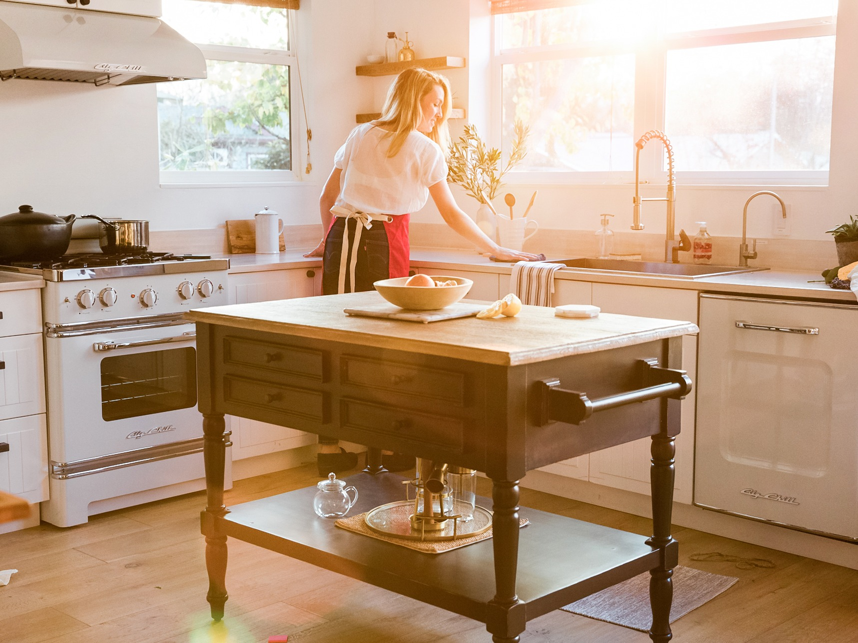 woman in the kitchen during sunset
