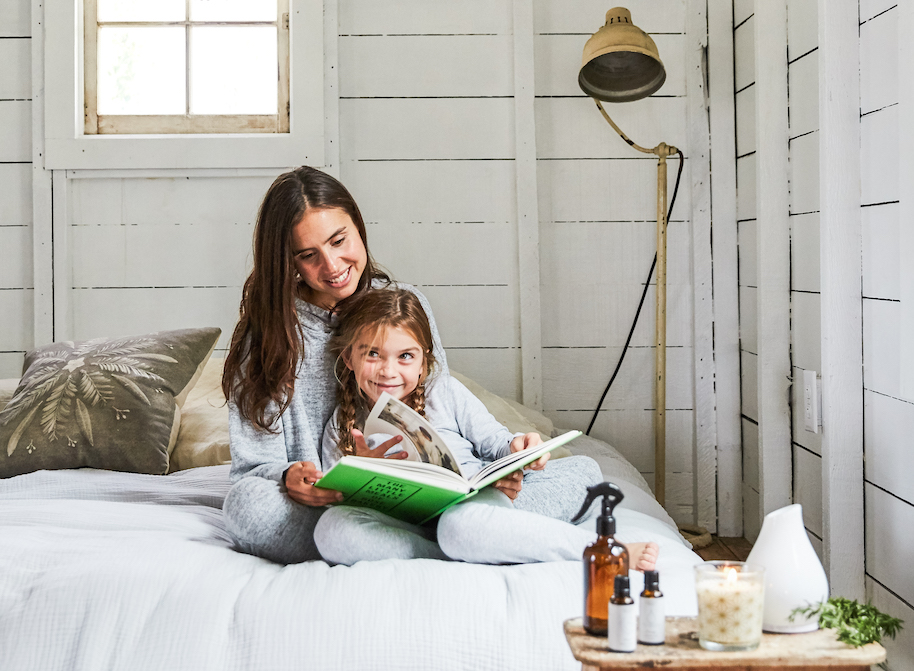 mom and child in bed reading a book together