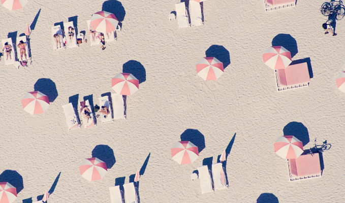 Image of umbrellas and sunbeds on the beach